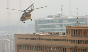 Afghan National Army (ANA) soldiers descend from helicopter on a roof of a military hospital during gunfire and blast in Kabul, Afghanistan