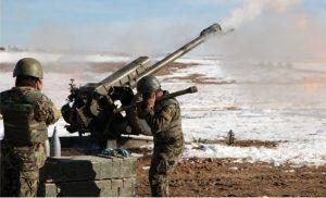 Afghan army firing artillery