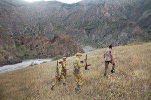 Borderguards patrolling the Tajik-Afghanistan border, a known drug corridor for opium and heroin. The road from Dushanbe, capital of Tajikistan, through the Tajik Pamir mountains and the autonomous region of Gorno-Badakhshan.